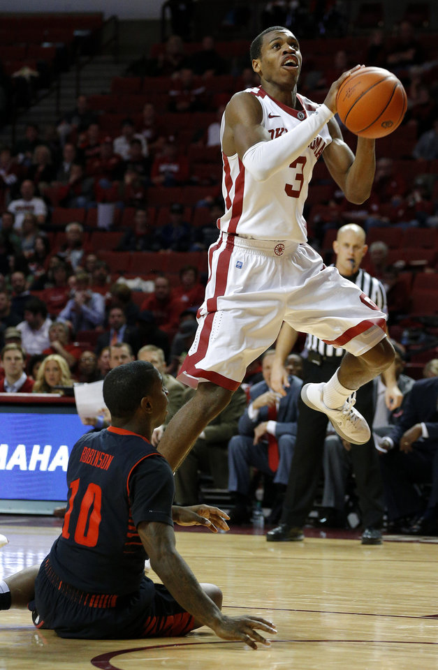 Oklahoma\'s Buddy Hield (3) goes past Texas Tech\'s Daylen Robinson (10) during an NCAA college basketball game between the University of Oklahoma and Texas Tech University at Lloyd Noble Center in Norman, Okla., Wednesday, Jan. 16, 2013. Photo by Bryan Terry, The Oklahoman