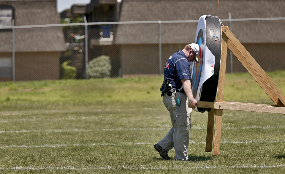 Crews move targets while setting up for the archery event during the Endeavor Games at the University of Central Oklahoma on Friday, June 7, 2013 in Edmond, Okla.  Photo by Chris Landsberger, The Oklahoman
