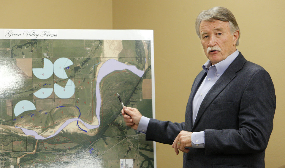 Photo -  Warren Thomas, managing partner of Tinker Business and Industrial Park, talks about drone research and development in Oklahoma while pointing to a map of Green Valley Farms near Lexington during a meeting at the Tinker Business and Industrial Park Monday, April 28, 2014. Photo by Paul B. Southerland, The Oklahoman   PAUL B. SOUTHERLAND -  PAUL B. SOUTHERLAND