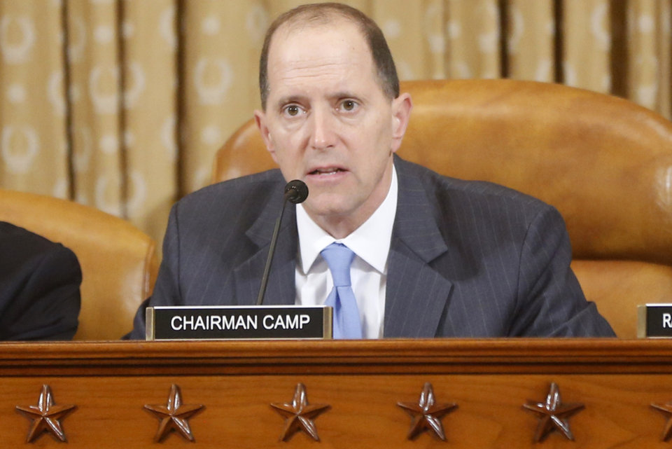 Photo - House Ways and Means Committee Chairman Rep. Dave Camp speaks on Capitol Hill, in Washington, Friday, May 17, 2013, prior to ousted IRS chief  Steve Miller and J. Russell George, Treasury Inspector General for Tax Administration, testifying before the committee's hearing on the Internal Revenue Service (IRS) practice of targeting applicants for tax-exempt status based on political leanings. (AP Photo/Charles Dharapak)
