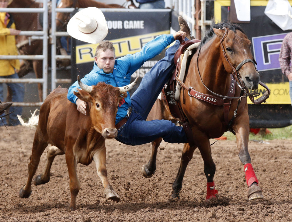 Hunter Washburn, from Shawnee, OK, competes in the Steer Wrestling event in Thursday's action at the International Finals Youth Rodeo at the Heart of Exposition Center in Shawnee, OK, Thursday, July 10, 2014,  Photo by Paul Hellstern, The Oklahoman