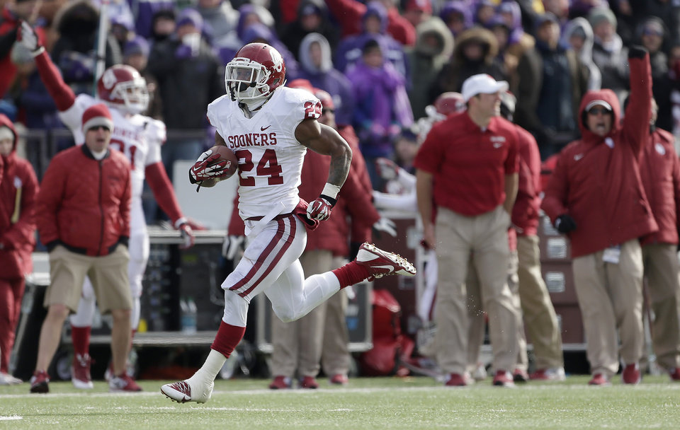 Oklahoma running back Brennan Clay (24) runs the ball for a touchdown during the first half of an NCAA college football game against Kansas State Saturday, Nov. 23, 2013 in Manhattan, Kan. (AP Photo/Charlie Riedel)