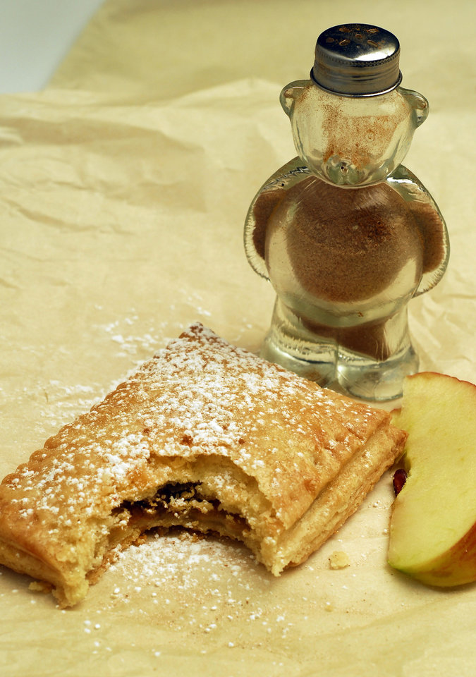 Put a homemade spin on pop-tarts while satisfying our grown-up palates. Here, sauteed apple with dried cranberries and cinnamon-sugar pop-tart. (Mark DuFrene/Contra Costa Times/MCT)