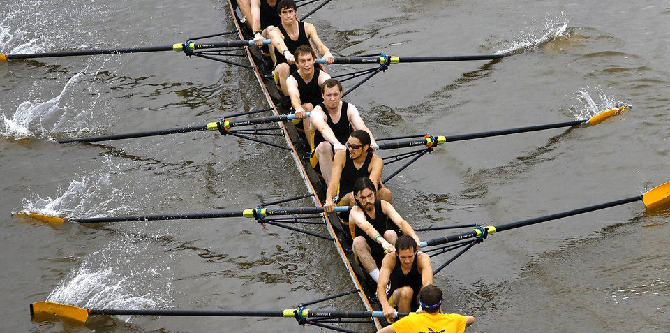 Photo - A team from Wichita State University competes in a race during the 2012 Oklahoma Regatta Festival on the Oklahoma River. Photos by Jim Beckel, The Oklahoman archives