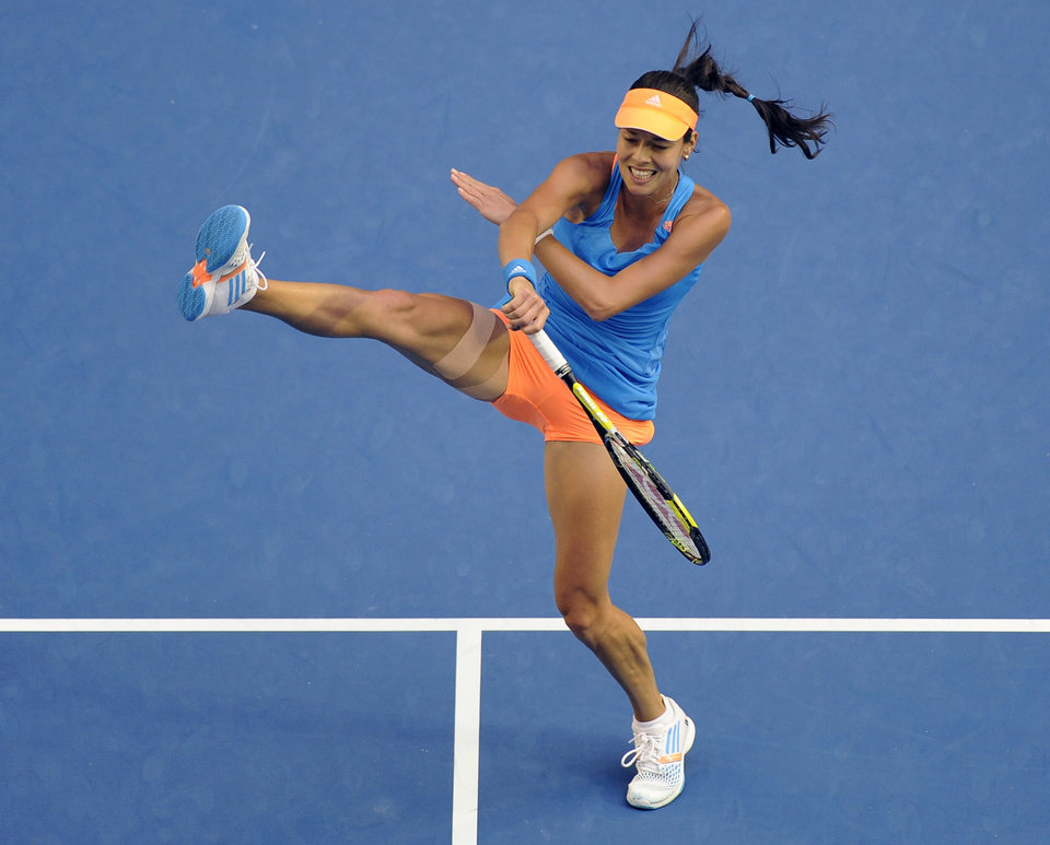 Photo - Ana Ivanovic of Serbia hits a smash to Samantha Stosur of Australia during their third round match at the Australian Open tennis championship in Melbourne, Australia, Friday, Jan. 17, 2014.(AP Photo/Andrew Brownbill)