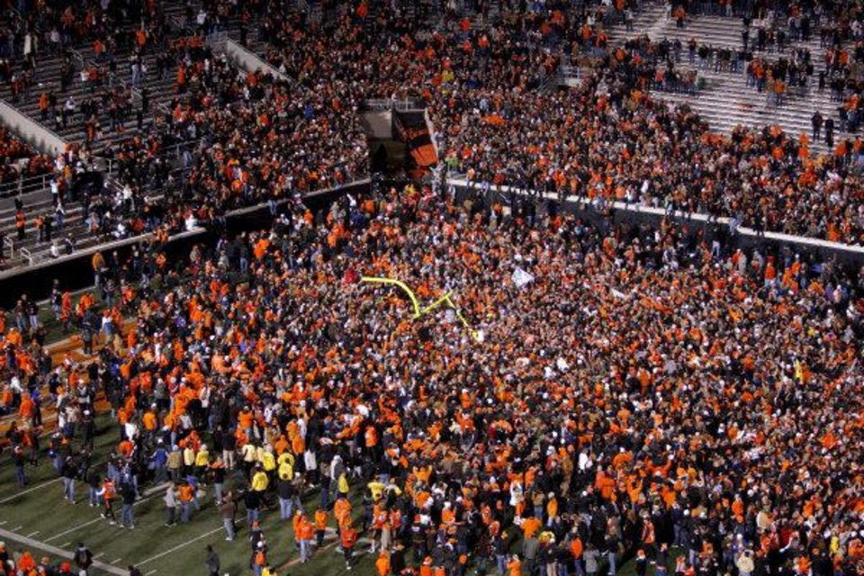 Oklahoma State fans celebrate following the Bedlam college football game between the Oklahoma State University Cowboys (OSU) and the University of Oklahoma Sooners (OU) at Boone Pickens Stadium in Stillwater, Okla., Saturday, Dec. 3, 2011. Photo by Bryan Terry, The Oklahoman <strong>BRYAN TERRY</strong>