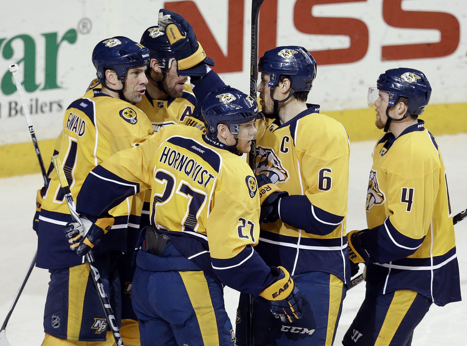 Photo - Nashville Predators forward Patric Hornqvist (27), of Sweden, celebrates with David Legwand (11), Shea Weber (6) and Ryan Ellis (4) after Hornqvist scored against the Colorado Avalanche in the second period of an NHL hockey game Saturday, Jan. 18, 2014, in Nashville, Tenn. (AP Photo/Mark Humphrey)