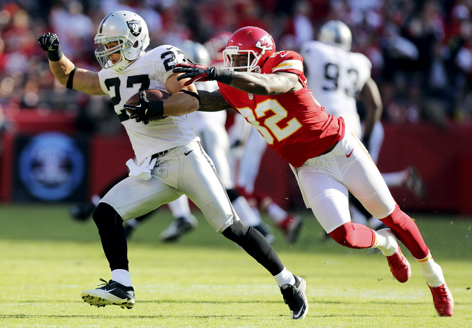 Photo -   Oakland Raiders free safety Matt Giordano (27) is tackled by Kansas City Chiefs wide receiver Dwayne Bowe (82) after an interception during the first half of an NFL football game at Arrowhead Stadium in Kansas City, Mo., Sunday, Oct. 28, 2012. (AP Photo/Ed Zurga)
