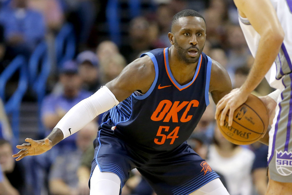 Photo - Oklahoma City's Patrick Patterson (54) defends during an NBA basketball game between the Oklahoma City Thunder and the Sacramento Kings at Chesapeake Energy Arena in Oklahoma City, Sunday, Oct. 21, 2018. Photo by Bryan Terry, The Oklahoman