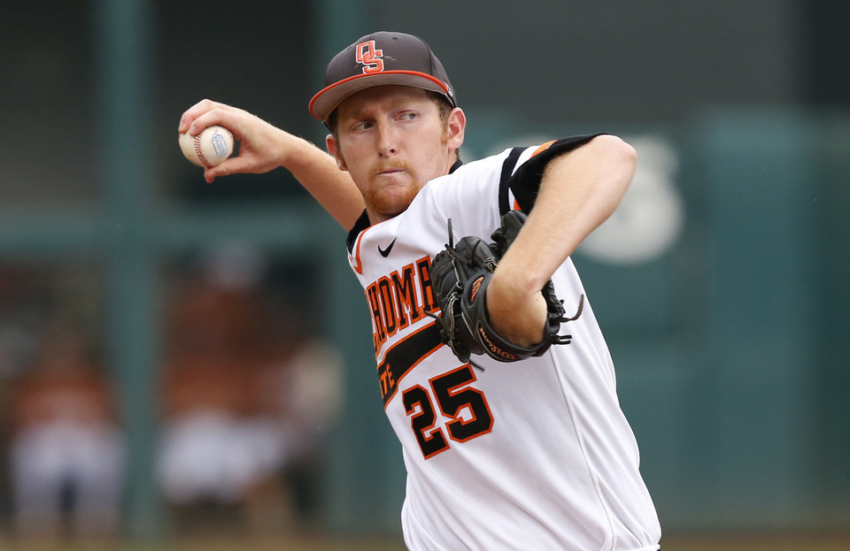 Photo - Oklahoma State's Trey Cobb (25) pitches in the first inning against Texas in a semifinal game at the Big 12 conference baseball tournament in Oklahoma City, Saturday, May 24, 2014. AP Photo/Sue Ogrocki)