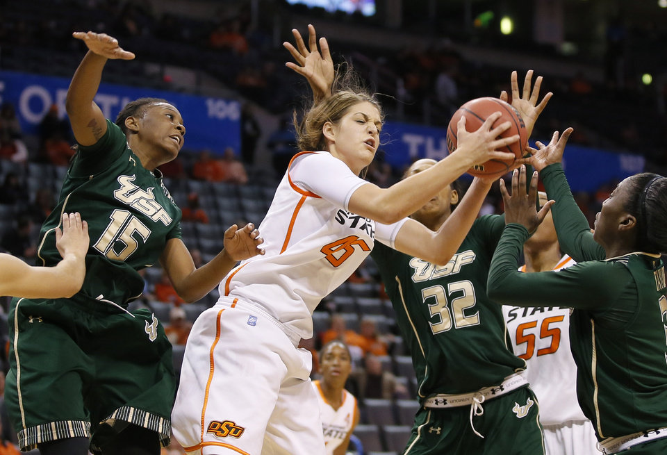 Oklahoma State's Katelyn Loecker (45) fights for the ball beside South Florida's Shavontae Naylor (15) and Akila McDonald (32) during the All-College Classic women's basketball game between Oklahoma State University and South Florida at Chesapeake Energy Arena in Oklahoma City, Okla., Saturday, Dec. 14, 2013. Photo by Bryan Terry, The Oklahoman