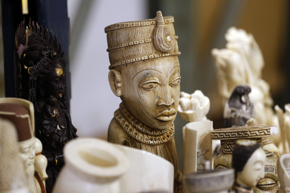 Photo - An ivory carving stands a head above others on display at the at the the National Wildlife Property Repository at the Rocky Mountain Arsenal National Wildlife Refuge near Commerce City, Colo., on Wednesday, Nov. 13, 2013. The item is part over 6-tons of ivory tusk and carvings worth millions of dollars that will be crushed at the facility on Thursday. The items were seized from smugglers, traders and tourists at U.S. ports of entry after a global ban on the ivory trade went into effect in 1989. (AP Photo/Ed Andrieski)