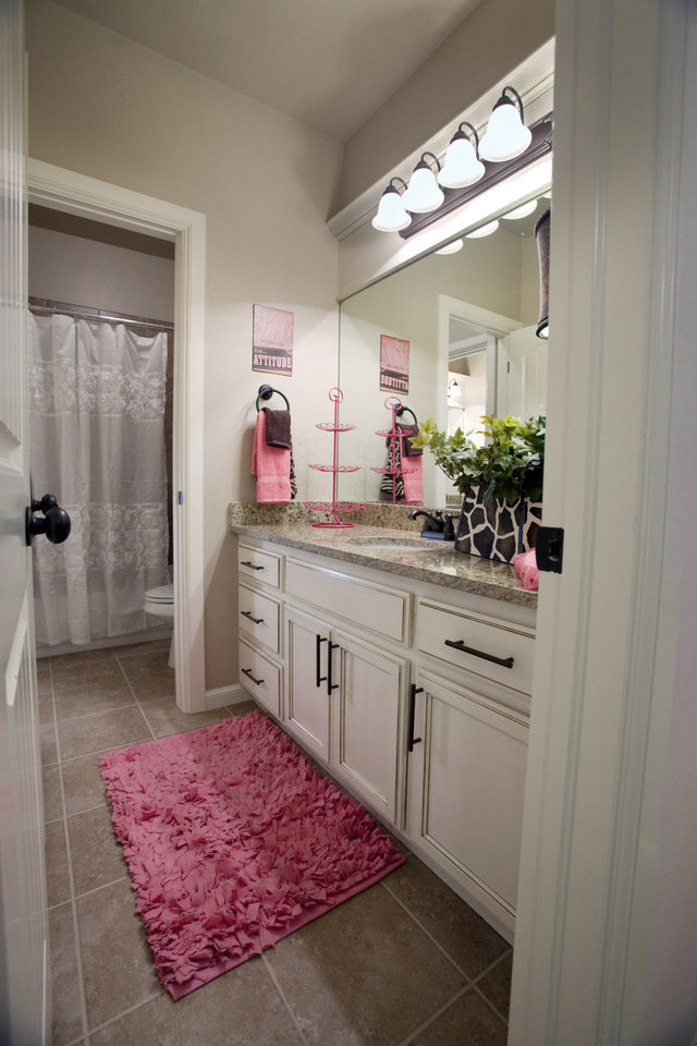 Landmark Fine Homes bathroom joins two bedrooms in a model home at 4601 Kingsland Road on Thursday, March 8, 2012, in Norman, Okla.  Photo by Steve Sisney, The Oklahoman