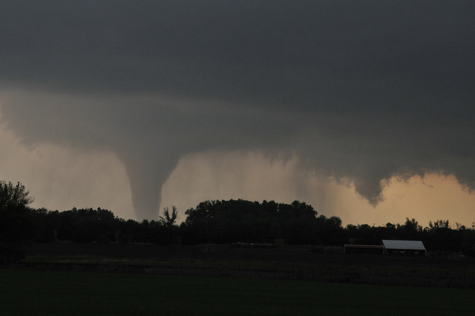 Photo -   A tornado moves on the ground north of Solomon, Kan., on Saturday evening, April 14, 2012, with I-70 seen in the foreground. (AP Photo/The Hutchinson News, Sandra J. Milburn)