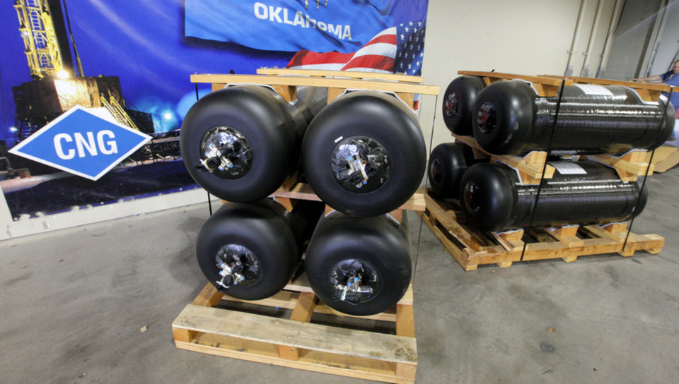 Photo -  New CNG tanks are scheduled for installation in vehicles from Heartland Energy Options in Oklahoma City. Photo by Paul B. Southerland, The Oklahoman   PAUL B. SOUTHERLAND -