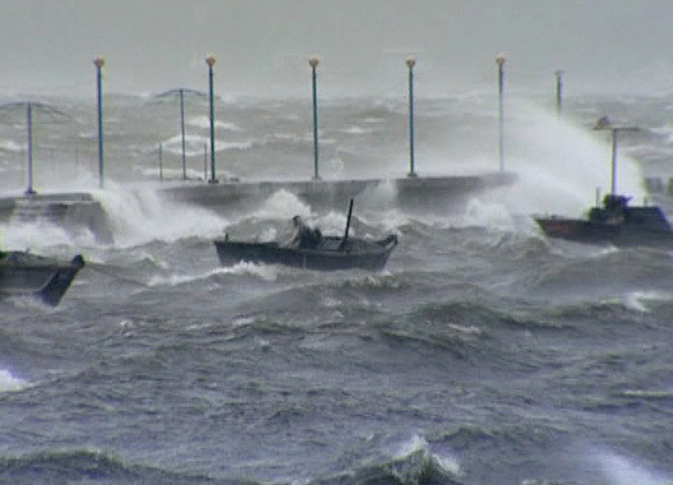 Photo -   In this image made off North Korea's Korean Central News Agency video footage, a person rides on a small boat in the rough seas off Wonsan City in Kangwon Province, North Korea, as a typhoon hits the area on Tuesday, Aug. 28, 2012. A second typhoon in less than a week is approaching North Korea on Thursday, threatening more rain in a country where storms often mean catastrophe because of deforestation and fragile infrastructure. (AP Photo/Korean Central News Agency)