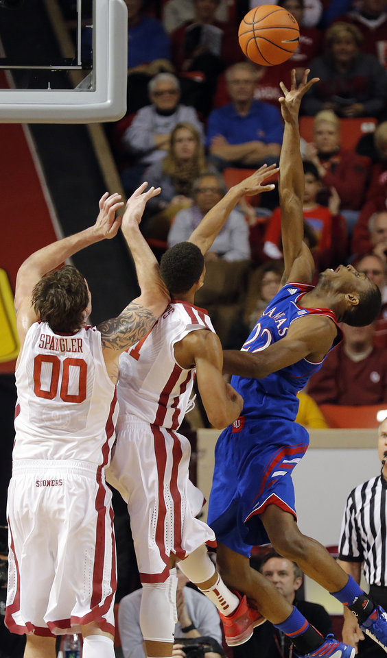 Photo - Kansas' Andrew Wiggins (22) shoots over Oklahoma's Isaiah Cousins (11) and Ryan Spangler (00) during the NCAA college basketball game between the University of Oklahoma Sooners (OU) and the University of Kansas (KU) Jayhawks at Lloyd Nobel Center in Norman,  Okla. on Wednesday, Jan. 8, 2014.   .Photo by Chris Landsberger, The Oklahoman