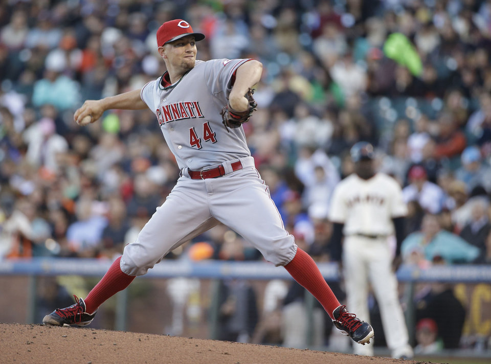 Photo - Cincinnati Reds starting pitcher Mike Leake throws against the San Francisco Giants in the first inning of their baseball game Thursday, June 26, 2014, in San Francisco. (AP Photo/Eric Risberg)
