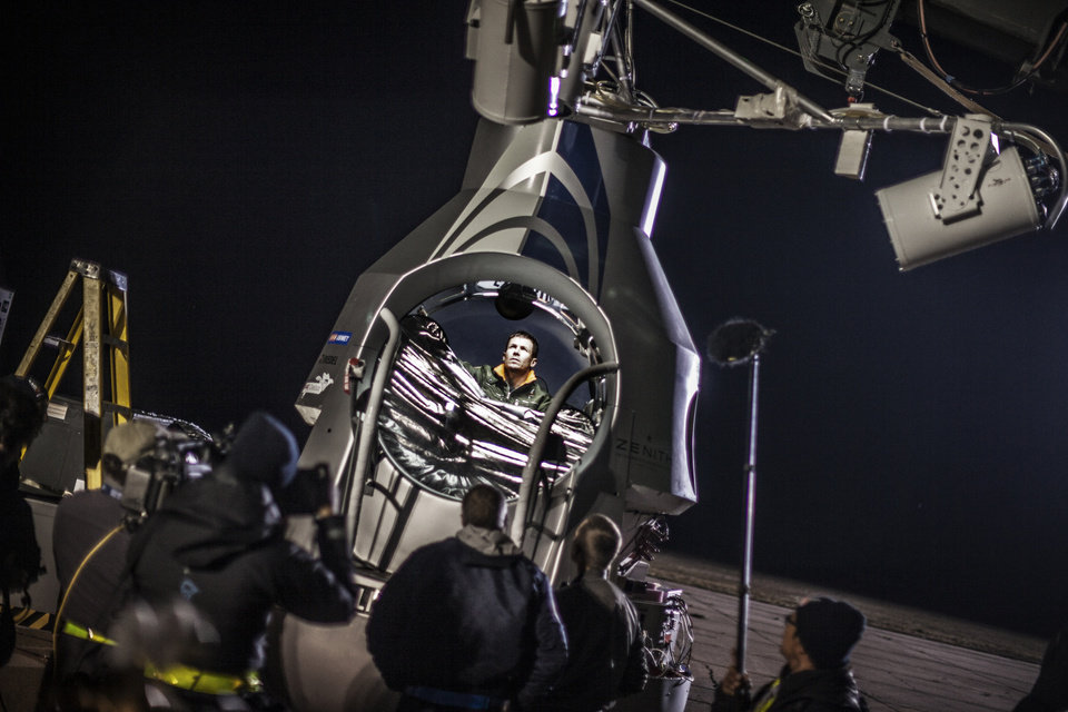 This image provided by Red Bull Stratos shows pilot Felix Baumgartner of Austria sitting in his capsule in preparation for the final manned flight of Red Bull Stratos in Roswell, N.M., Tuesday Oct. 9, 2012. Baumgartner canceled his planned death-defying 23-mile free fall on Tuesday because of high winds, the second time this week he was forced to postpone his quest to be the first supersonic skydiver. (AP Photo/Red Bull Stratos)