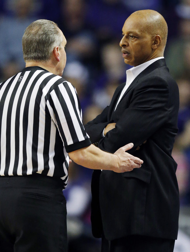 Photo - TCU head coach Trent Johnson talks with a game official during the first half of an NCAA college basketball game against Kansas State in Manhattan, Kan., Wednesday, Feb. 19, 2014. (AP Photo/Orlin Wagner)