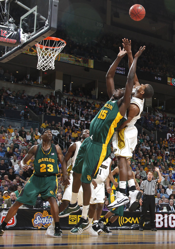 Baylor's Mamadou Diene (15) battles for a rebound with a Missouri defender in the Championship game of the Big 12 Men's Basketball Championships between Baylor University and The University of Missouri at the Ford Center on Saturday, March 14, 2009, in Oklahoma City, Okla.