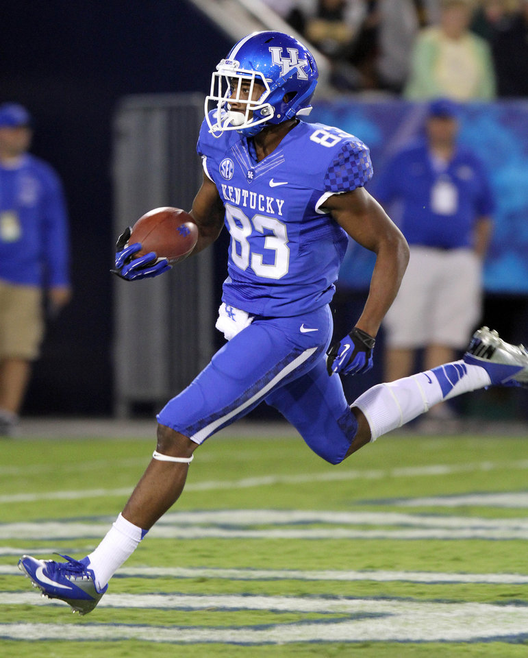 Photo -   Kentucky's DeMarcus Sweat scores during the fourth quarter of a NCAA College Football game against Kent State at Commonwealth Stadium in Lexington, Ky., Saturday, Sep. 8, 2012. Kentucky won 47-14. (AP Photo/James Crisp)