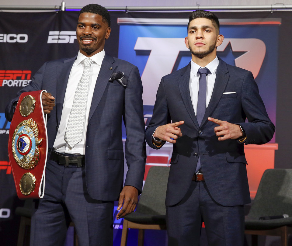 Photo - Maurice Hooker, left, and Alex Saucedo pose for a photo at the end of a press conference for their WBO junior welterweight world title fight, at the Sheraton Hotel in Oklahoma City, Nov. 14, 2018. Photo by Nate Billings, The Oklahoman