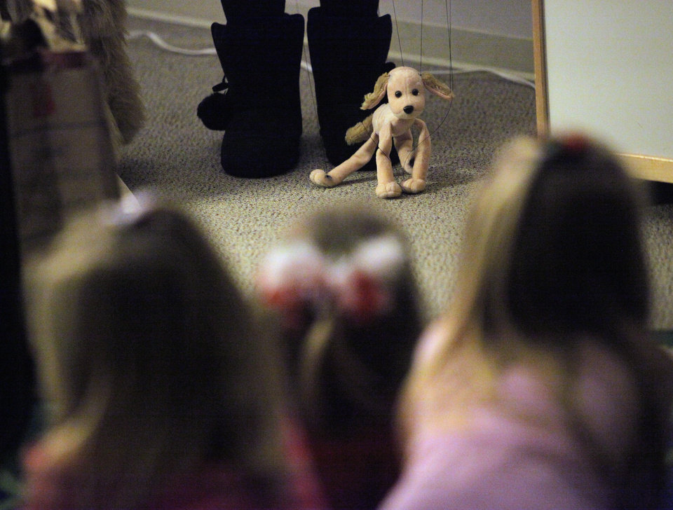Children watch Claire the dog during an It's a Mrs. Sky Story puppet show at the Choctaw Library in Choctaw, Okla., Monday, Dec. 19, 2011. Photo by Nate Billings, The Oklahoman