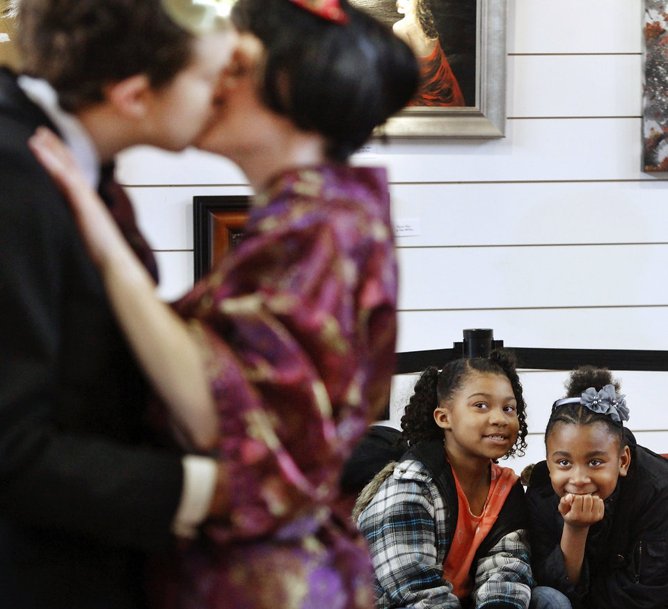 India Irish, left, and Romiah Dorris focus on two actors kissing in this scene from