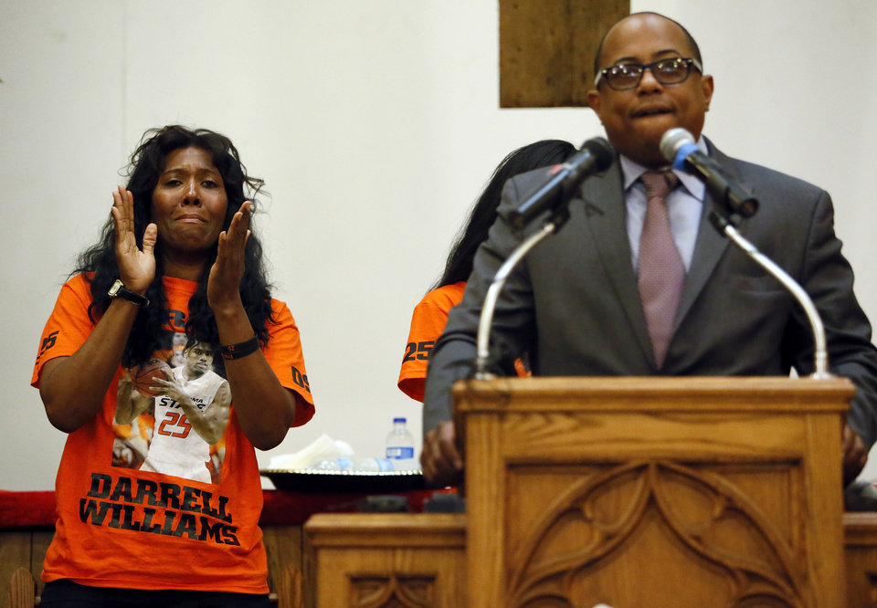 Photo - Alice Williams, mother of Darrell Williams, applauds as Bishop Tavis Grant, National Field Director for the Rainbow/PUSH Coalition, speaks about Darrell Williams during a rally in support of Williams at Mt. Zion Baptist Church in Stillwater, Okla., Thursday, Aug. 23, 2012. Williams, a suspended Oklahoma State basketball player, was found guilty on two counts of rape by instrumentation and one count of sexual battery after an incident at a house party. Photo by Nate Billings, The Oklahoman