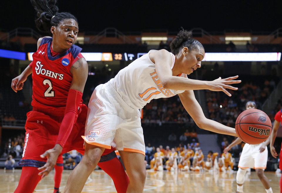 Photo - Tennessee forward Cierra Burdick (11) grabs a rebound in front of St. John's forward Amber Thompson (2) in the first half of an NCAA women's college basketball second-round tournament game Monday, March 24, 2014, in Knoxville, Tenn. (AP Photo/John Bazemore)