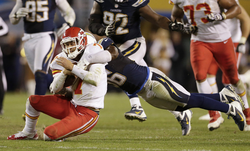 Kansas City Chiefs quarterback Matt Cassel, left, is brought down by San Diego Chargers linebacker Donald Butler during an NFL football game Thursday, Nov. 1, 2012, in San Diego. The Chargers won 31-13. (AP Photo/Gregory Bull)