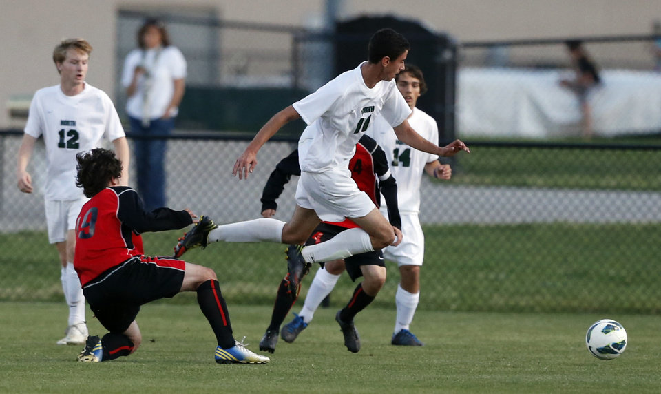Photo - (Hold for Ed Godfrey Friday Story) Norman North soccer player Mauro Cichero (11) plays against Yukon in a playoff game on Tuesday, April 30, 2013 in Norman, Okla.  Photo by Steve Sisney, The Oklahoman