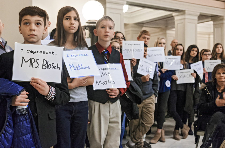 Photo - Students hold signs to show support for their teachers during a rally to support the Step Up Oklahoma Plan at the state capitol in Oklahoma City, Okla. on Monday, Feb. 12, 2018.    Photo by Chris Landsberger, The Oklahoman