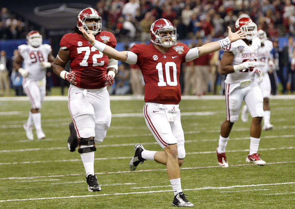 Photo - Alabama's AJ McCarron (10) reacts after a touchdown pass during the NCAA football BCS Sugar Bowl game between the University of Oklahoma Sooners (OU) and the University of Alabama Crimson Tide (UA) at the Superdome in New Orleans, La., Thursday, Jan. 2, 2014.  .Photo by Chris Landsberger, The Oklahoman