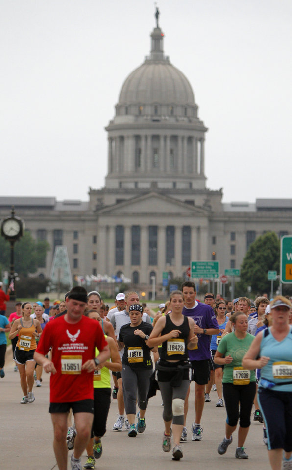 Runners make their way past the state Capitol during the Oklahoma City Memorial Marathon in Oklahoma City, Sunday, April 29, 2012. Photo by Bryan Terry, The Oklahoman