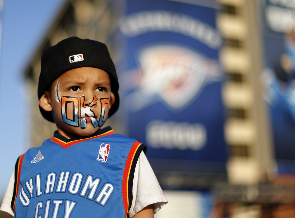 Photo - Aden Lumpmouth-Sam, 4, watches activities in Thunder Alley before Game 1 in the first round of the NBA playoffs between the Oklahoma City Thunder and the Houston Rockets at Chesapeake Energy Arena in Oklahoma City, Sunday, April 21, 2013. Photo by Sarah Phipps, The Oklahoman
