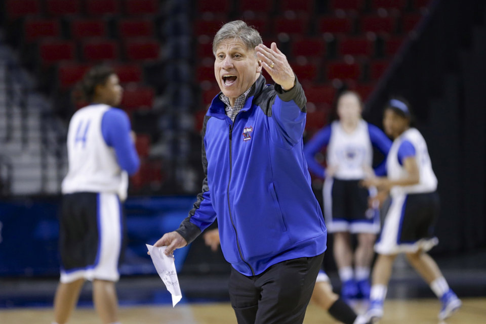 Photo - DePaul coach Doug Bruno addresses players during practice in Lincoln, Neb., Friday, March 28, 2014. DePaul will play Texas A&M in an NCAA women's college basketball tournament regional semifinal on Saturday. (AP Photo/Nati Harnik)
