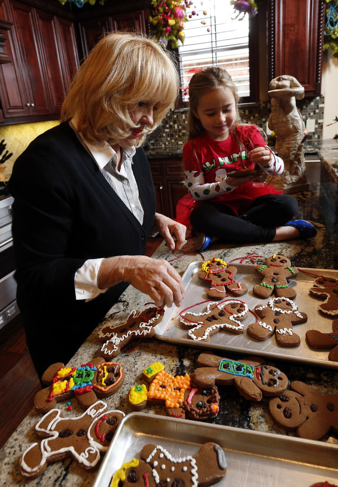 Photo - Debbie McCurdy and granddaughter Alivia Hutchinson, 4, string homemade gingerbread men to decorate a tree. PHOTO BY STEVE SISNEY, THE OKLAHOMAN  STEVE SISNEY