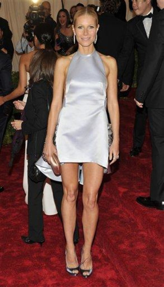 Photo - Gwyneth Paltrow arrives at the Metropolitan Museum of Art Costume Institute gala benefit, celebrating Elsa Schiaparelli and Miuccia Prada, Monday, May 7, 2012 in New York. (AP Photo/Charles Sykes)