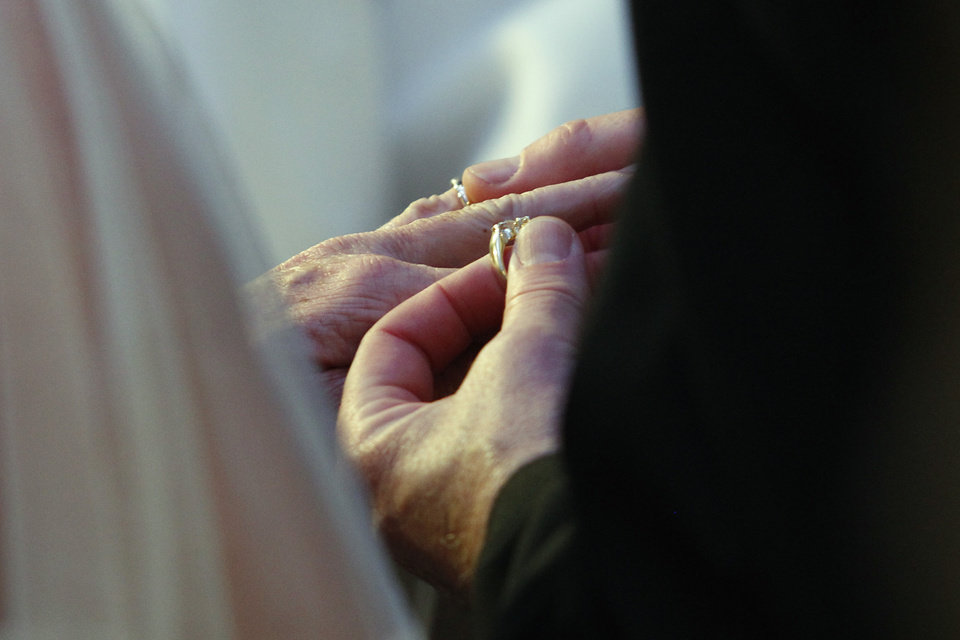 Steve Keller places a ring on Nancy Levindowski's finger as they exchange wedding vows at the Denny's restaurant on Fremont Street in Las Vegas, Wednesday, April 4, 2013. (AP Photo/Las Vegas Sun, Sam Morris)
