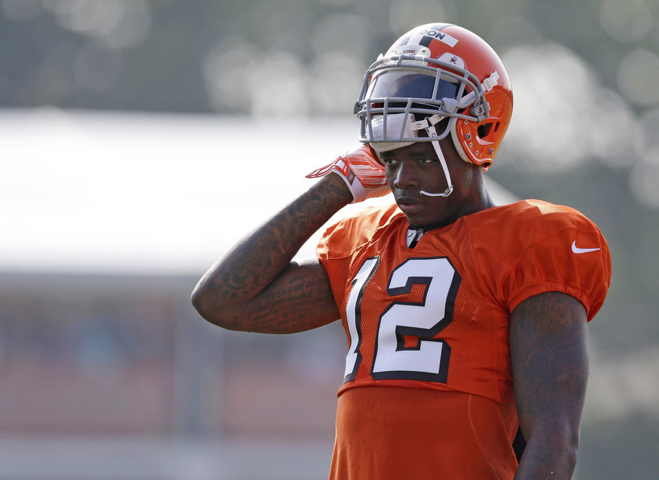 Photo - FILE - In this Aug. 4, 2014, file photo, Cleveland Browns wide receiver Josh Gordon rests during practice at the NFL football team's training campin Berea, Ohio. Gordon has been suspended by the NFL one year for violating the league's substance abuse policy. Gordon's suspension is effective immediately and he will miss the entire 2014 season.  (AP Photo/Tony Dejak, File)