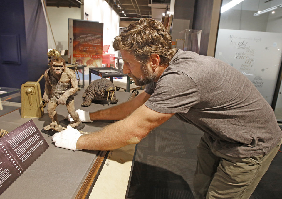 "Photo - Scott Henderson, director of smART Space sets up the Troglodyte from Ray Harryhausen's ""Sinbad and the Eye of the Tiger""  at Science Museum Oklahoma in Oklahoma City, Monday July 24, 2017. Photo By Steve Gooch, The Oklahoman"