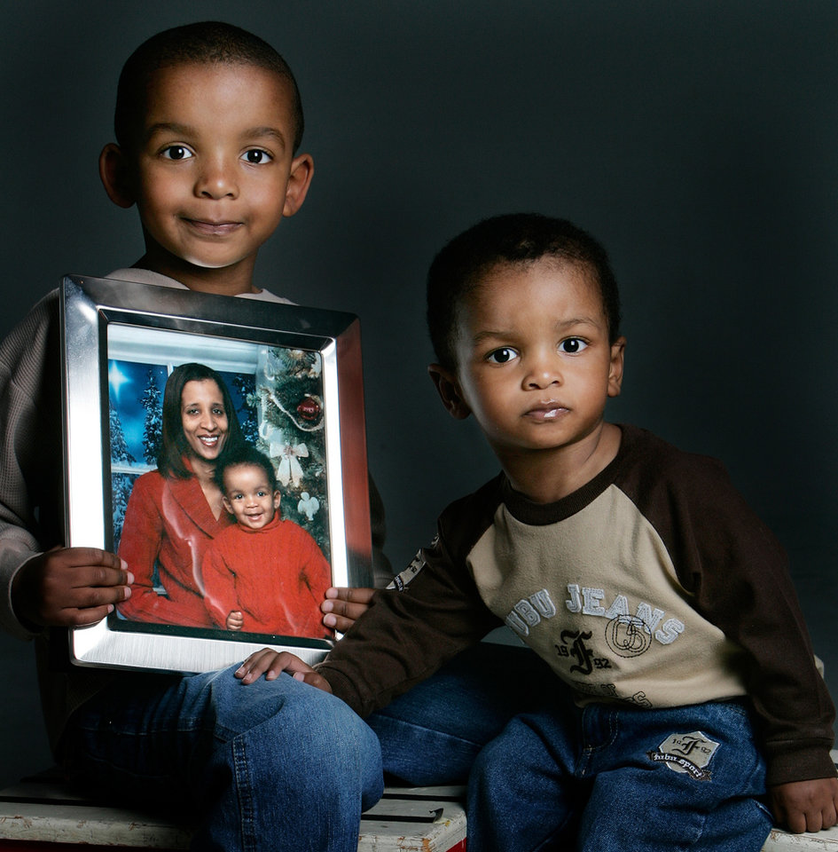 Photo - DEATH: Josiah Washington ,5, holds a photo of his mother Jennifer Washington who was killed by an uninsured drunk driver and he is seated next to his brother Jeridan Washington, 1, in the  studio Saturday, March 29, 2008 in Oklahoma City, OK. BY JACONNA AGUIRRE/THE OKLAHOMAN. ORG XMIT: KOD