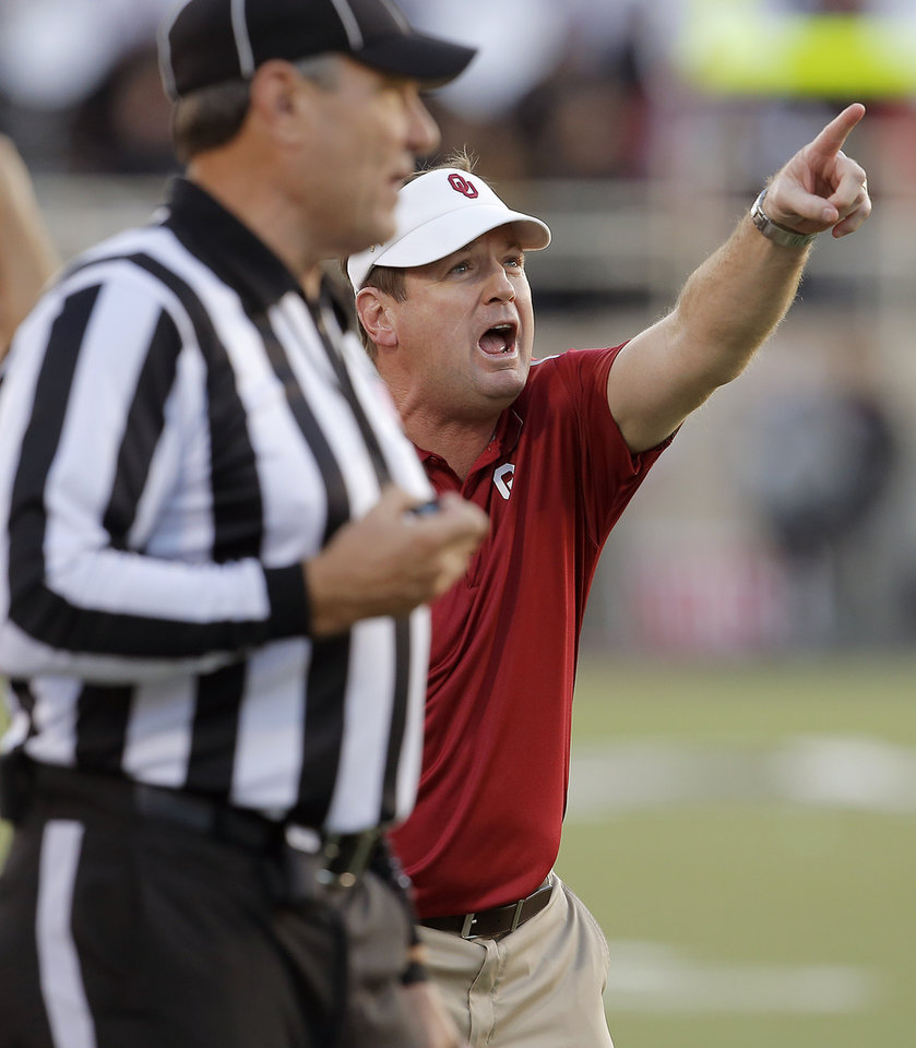 Photo - Oklahoma coach Bob Stoops points towards a screen showing a replay during a college football game between the University of Oklahoma Sooners (OU) and the Texas Tech Red Raiders at Jones AT&T Stadium in Lubbock, Texas, Saturday, November 15, 2014.  Photo by Bryan Terry, The Oklahoman
