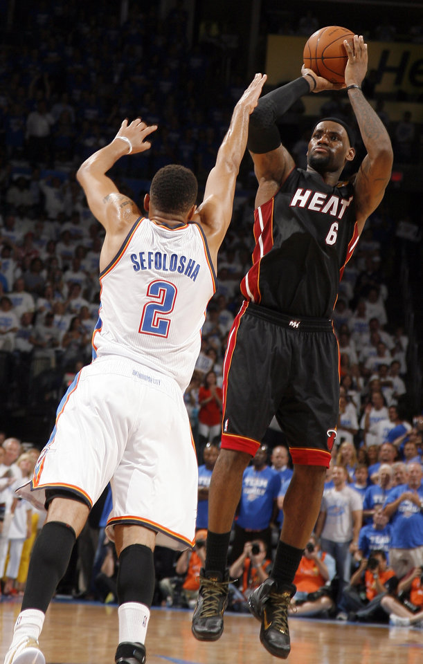 Miami's LeBron James (6) shoots over Oklahoma City's Thabo Sefolosha (2) during Game 2 of the NBA Finals between the Oklahoma City Thunder and the Miami Heat at Chesapeake Energy Arena in Oklahoma City, Thursday, June 14, 2012. Photo by Sarah Phipps, The Oklahoman