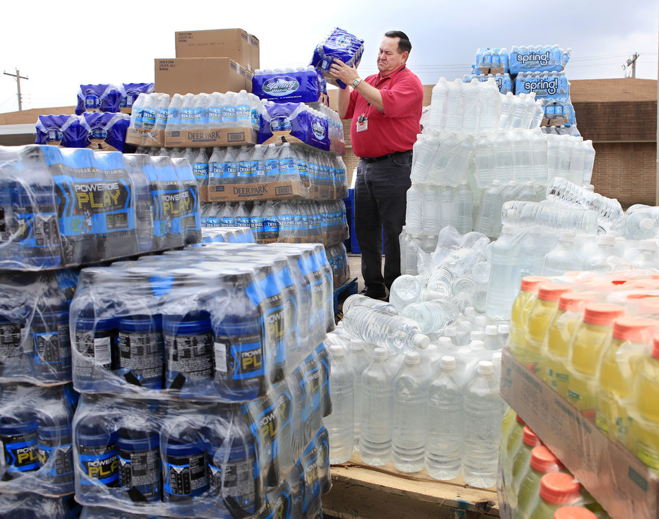 Melvin Potter lifts a case of bottled water from a pallet of supplies donated by local merchants in Tecumseh.  Potter is emergency management director for the city of Tecumseh. Wednesday, May 12, 2010. The water is among supplies and building materials  being made available to victims of Monday night's tornado that damaged or destroyed numerous homes in Pottawatomie County. Photo by Jim Beckel, The Oklahoman