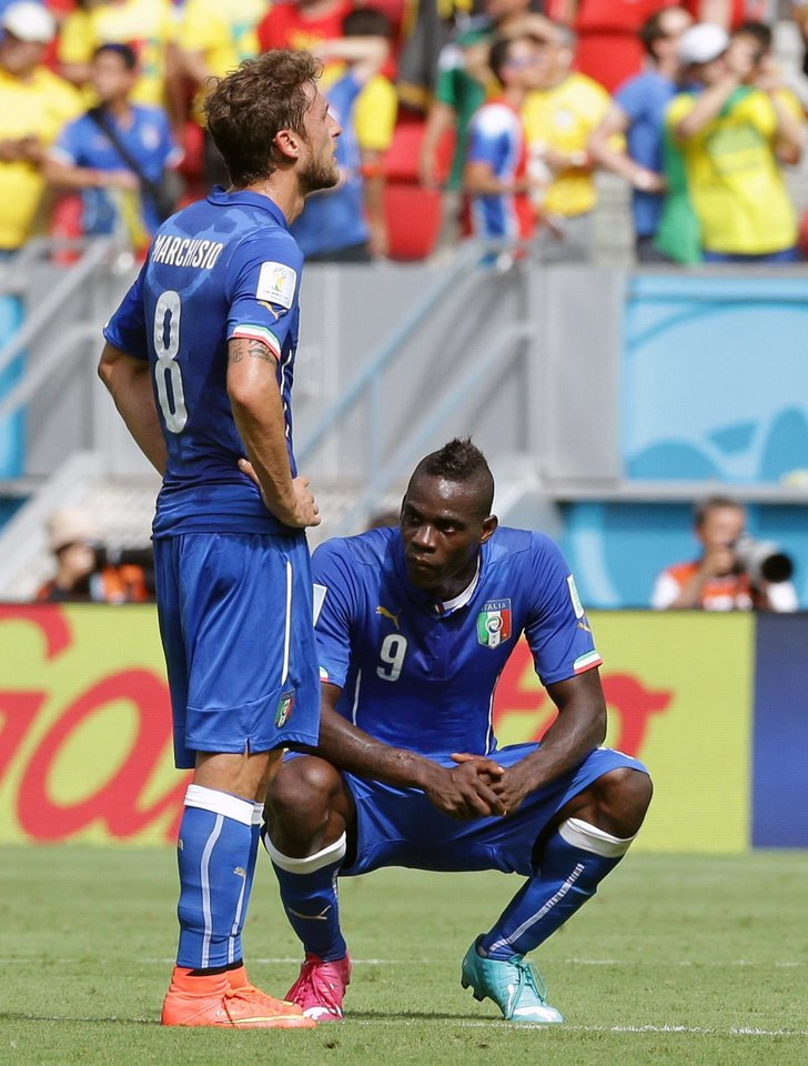 Photo - Italy's Mario Balotelli, right, and Italy's Claudio Marchisio react after Costa Rica's Bryan Ruiz scored the opening goal during the group D World Cup soccer match between Italy and Costa Rica at the Arena Pernambuco in Recife, Brazil, Friday, June 20, 2014.   (AP Photo/Antonio Calanni)