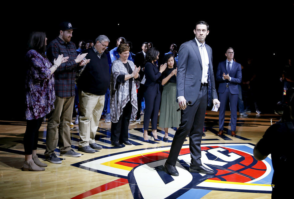 Photo - Nick Collison speaks to the crowd during a ceremony to retire his jersey number before an NBA basketball game between the Oklahoma City Thunder and the Toronto Raptors at Chesapeake Energy Arena in Oklahoma City, Wednesday, March 20, 2019. Photo by Bryan Terry, The Oklahoman
