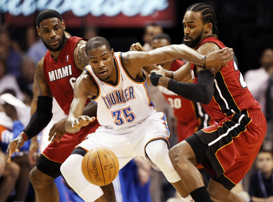 Oklahoma City\'s Kevin Durant (35) tries to keep control of the ball between Miami\'s LeBron James (6), left, and Ronny Turiaf (21) during the NBA basketball game between the Miami Heat and the Oklahoma City Thunder at Chesapeake Energy Arena in Oklahoma City, Sunday, March 25, 2012. Photo by Nate Billings, The Oklahoman